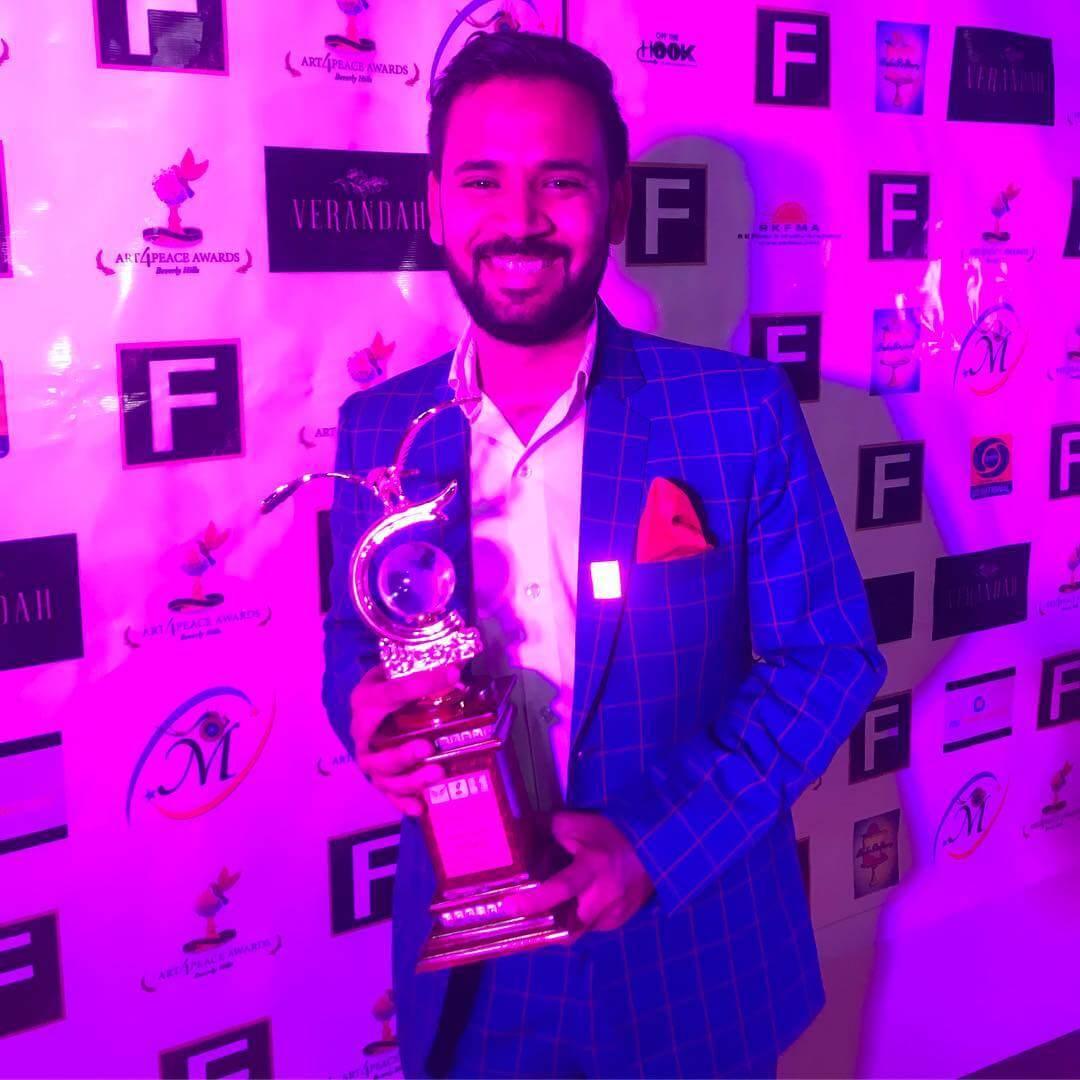 rj kartik with awards