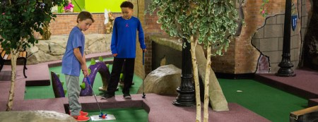 Indoor Mini Golf   Miniature Golf Courses   Grand Slam Family Fun     Golf  anyone  Grand Slam offers golf enthusiasts of all ages the  opportunity to putt around  all year round  with our 18 hole miniature golf  course