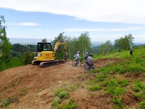 Building jumps, singletrack, and features with heavy machinery.