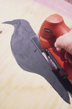 crow hunting wooden decoy