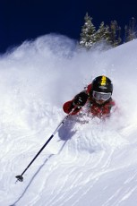 Rick Armstrong swims in an ocean of powder, Jackson backcountry, Wyoming