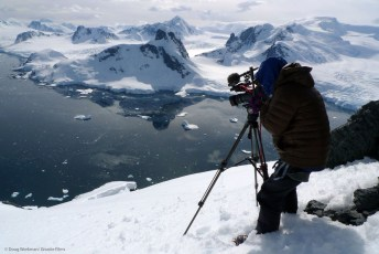 Jim Surette films from the summit of Mt. Demaria, Antarctica. Photo: Doug Workman