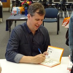 Author Jeff Kinney signs copies of his new book