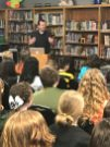 Author Brendan Reichs speaks to Evergreen Jr. High students in the media center