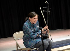 Photo of teacher displaying instrument at Spring Lane Elementary