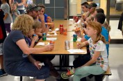 Photo of parents and students eating in cafeteria