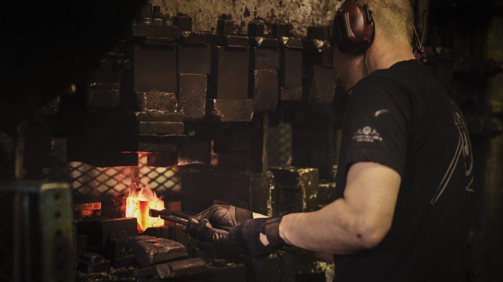 Blacksmith firing axe head