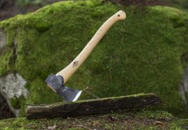 Axe on mossy log