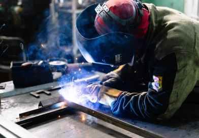 man welding metal bars