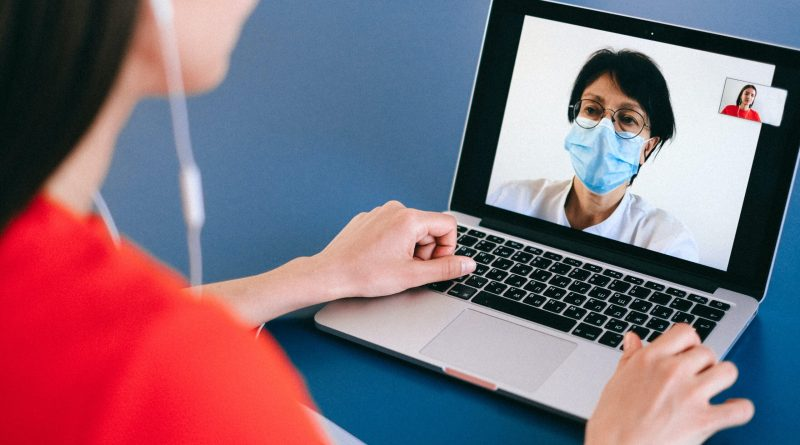Woman receiving telehealth services