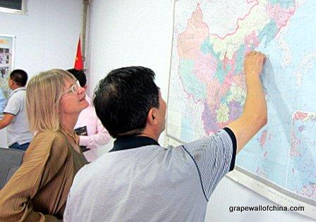 Jancis Robinson checks a map of China.