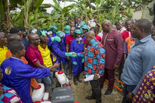 President Akufo-Addo interacting with the mass cocoa spraying officers