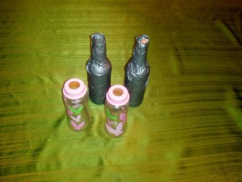 Wrap glass bottles in duct tape to reduce breaking and make for easy clean up if a bottle happens to break. Alternatively use plastic baby bottles with a half inch of water in them