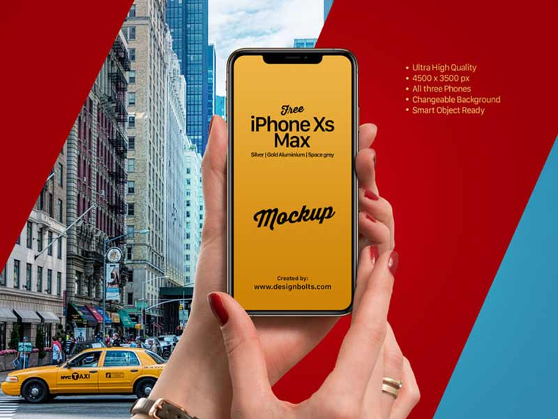 Free iPhone Xs Max in Female Hand Mockup PSD