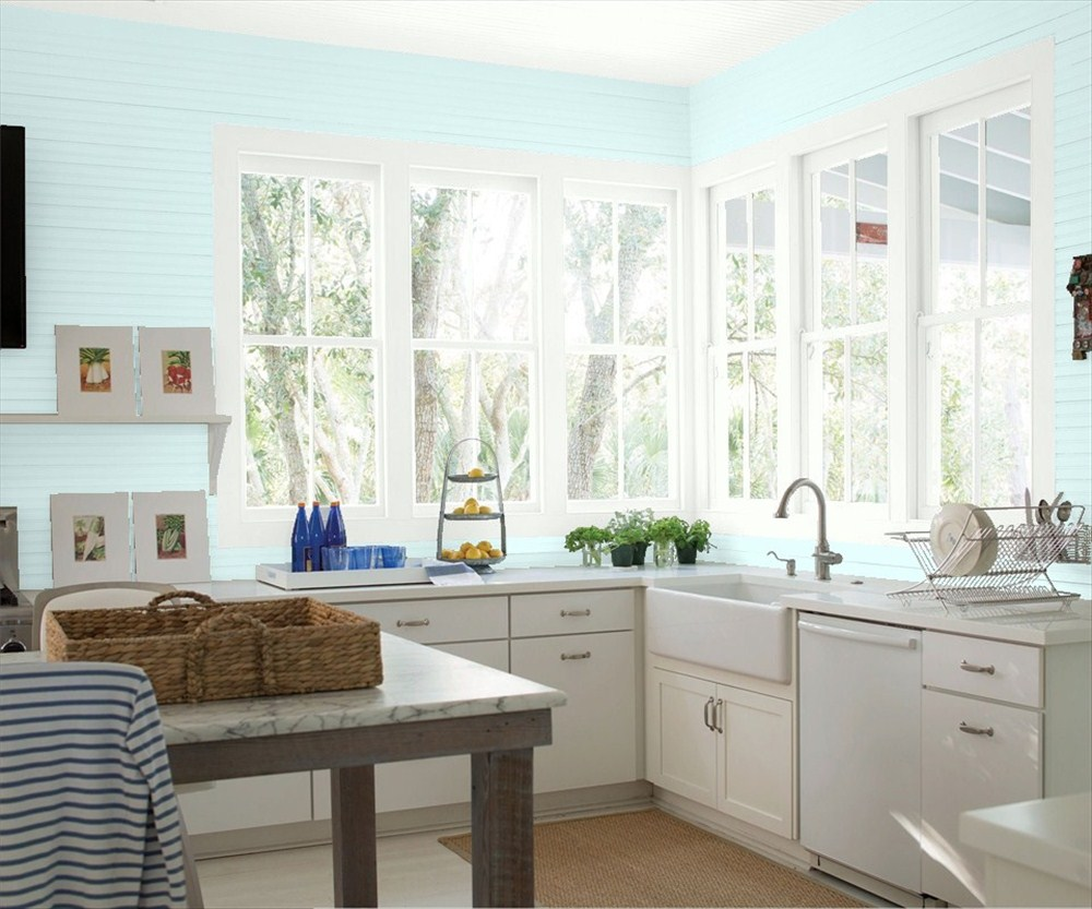 bright kitchen with ice blue wall paint and curve faucet