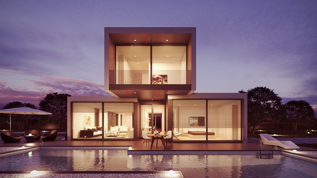cool architecture home with pool and glass wall