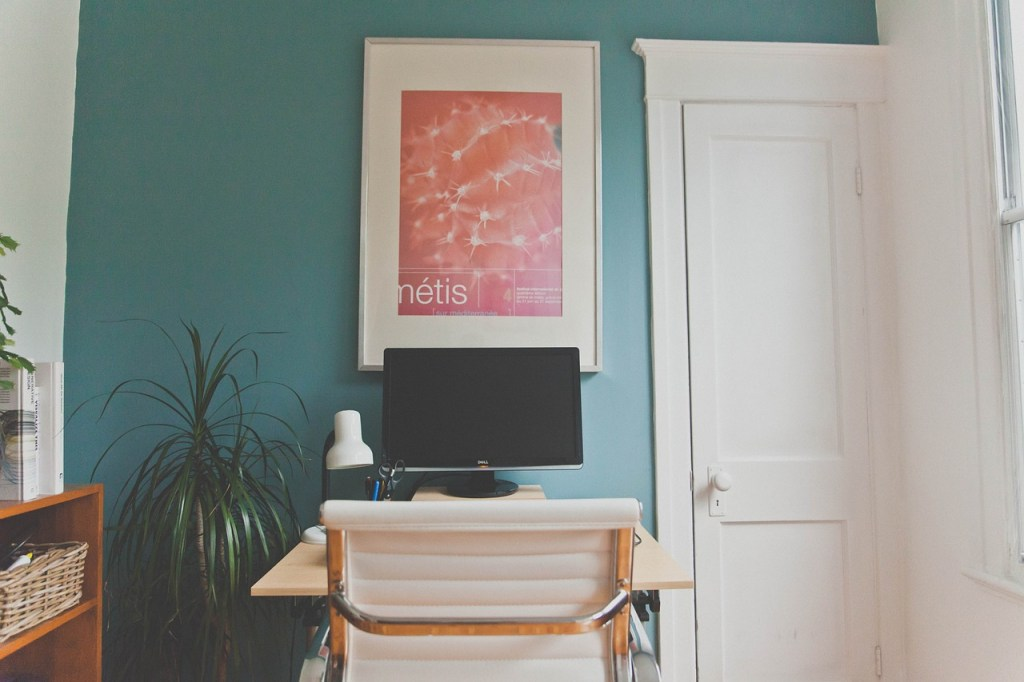 small space home office with wall art and plant also desk lamp