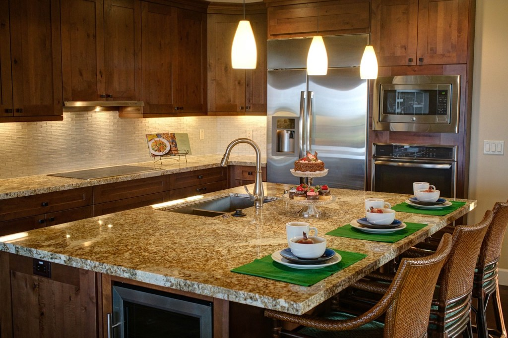 kitchen island as  dining table and wood cabinet and great pendant also furniture