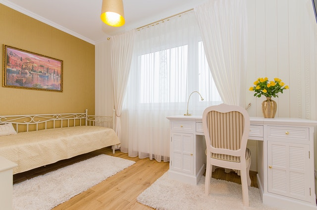 bedroom with home office and chair also curtain