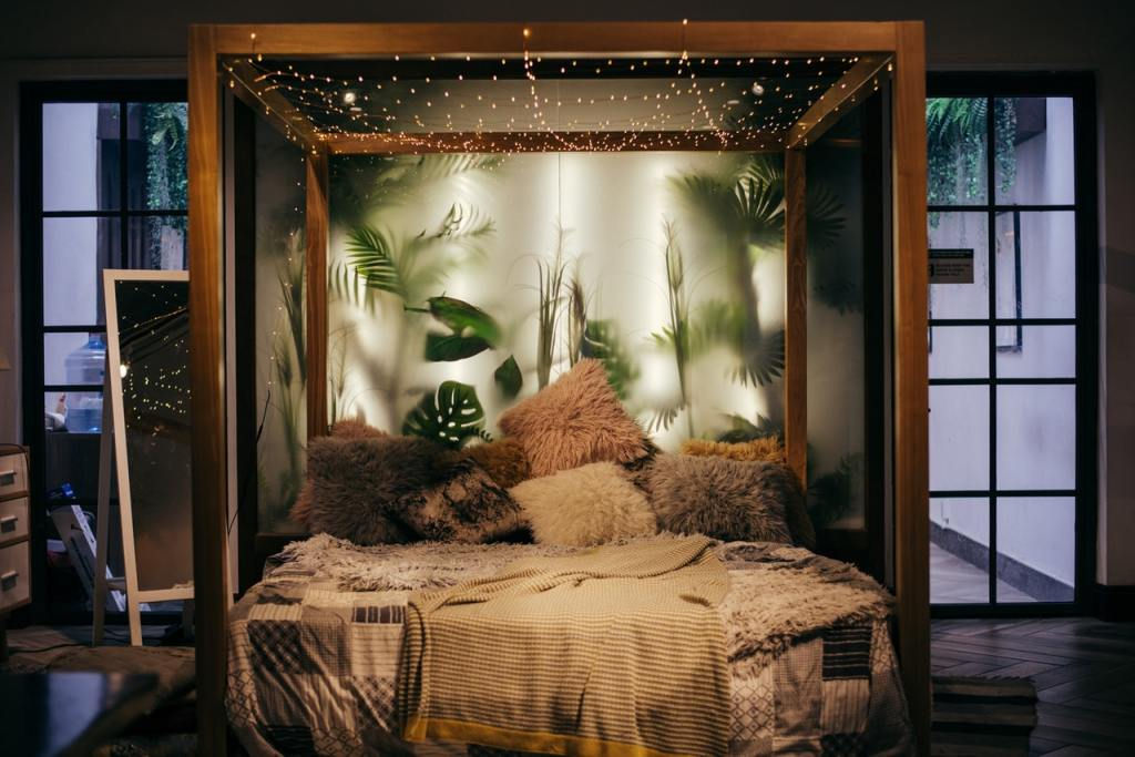 Bedroom Decorating Ideas for Couples with string lights hanged on bed frame