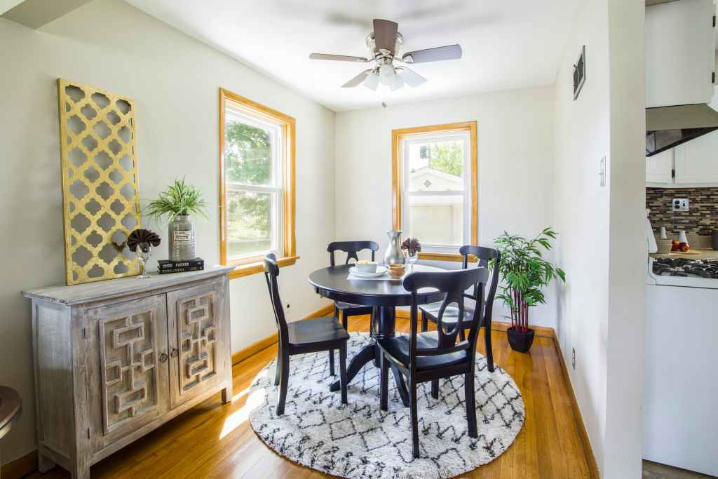Small Dining Room Decorating Ideas with wall art and plants also rug