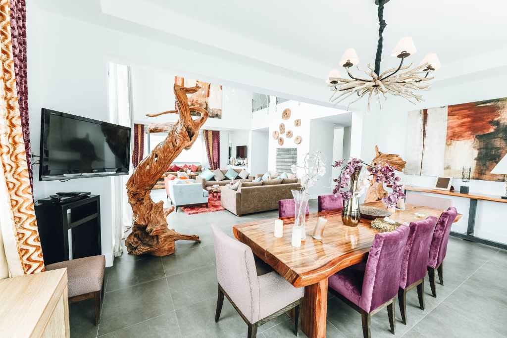 beautiful dining room with wooden dining table and rustic chandelier also wall art decor