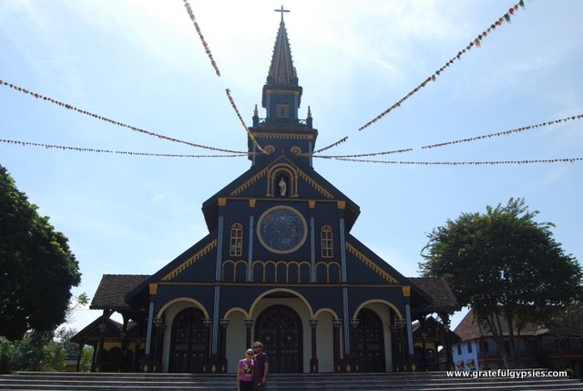 Visiting the historic wooden church.