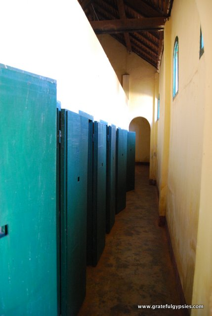 In the halls of a deserted French colonial prison.