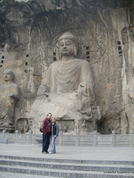 Dwarfed by the massive Buddha carving at the Longmen Grottoes.