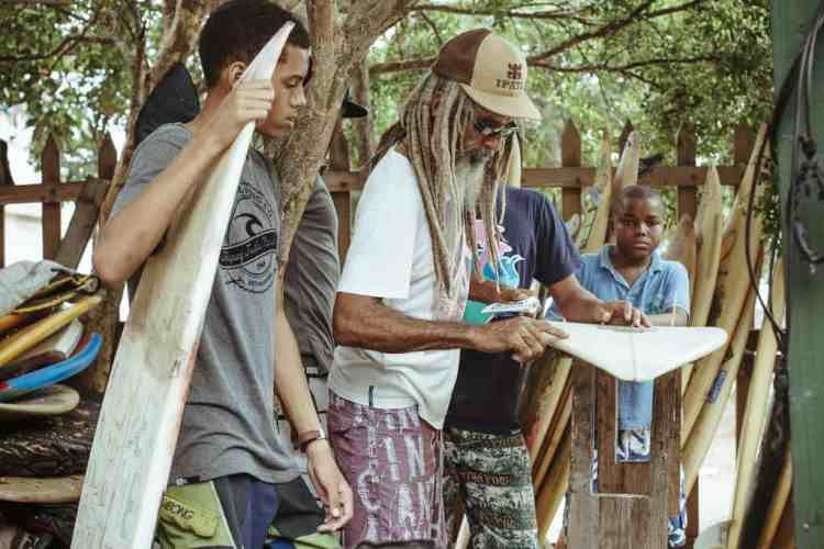"""Jamaican local Billy """"Mystic"""" Wilmott, who began riding waves on his body board in the 60s. His home, dubbed Jamnesia, serves as a gathering spot for the young local surfers, skateboarders, musicians and artists to come together.PHOTO: Grant Ellis"""