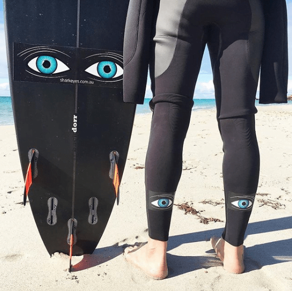shark eyes surf tiburon ataque wetsuit tabla
