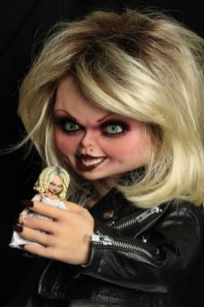 NECA Toys' Bride of Chucky life-size 1:1 scale Tiffany replica holding 7-inch scale action figure.