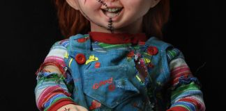 NECA Toys' Child's Play Bride of Chucky Chucky life-size 1:1 scale replica (seated).