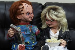 NECA Toys' Bride of Chucky Chucky life-size 1:1 scale replica with Tiffany (seated).