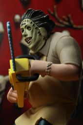 NECA Toys' Toony Terrors series 2 action figure Leatherface (angled left) with cutout backdrop.
