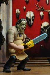 NECA Toys' Toony Terrors series 2 action figure Leatherface (angled right) with cutout backdrop.