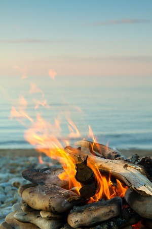 30789420 - inviting campfire on the beach during the summer