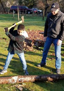 yule log celebration kid swinging axe