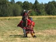 Two men fighting in field sca