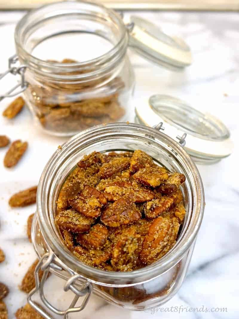 Sugar and Spice Pecans, overhead shot in glass jars. Nuts.