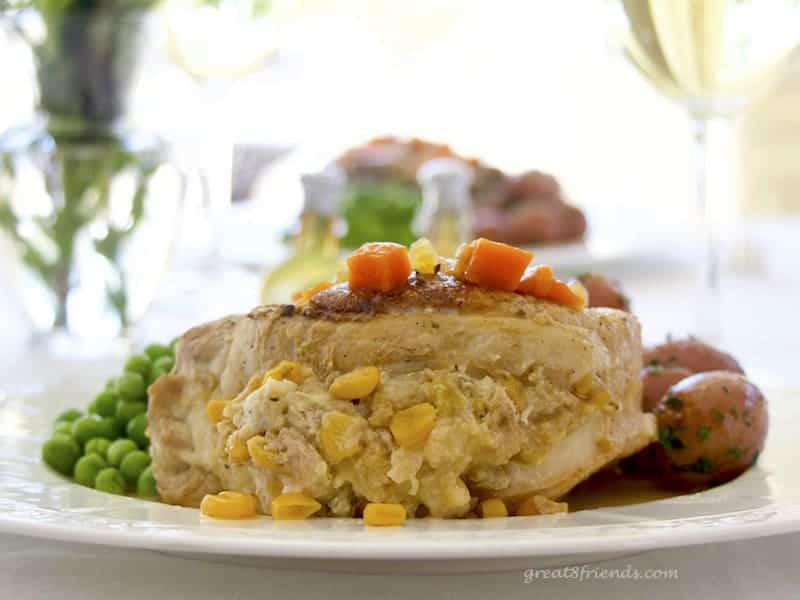 These Stuffed Pork Chops are the perfect company meal. They cook for an hour and a half, so you can enjoy your guests while this delicious meal cooks!