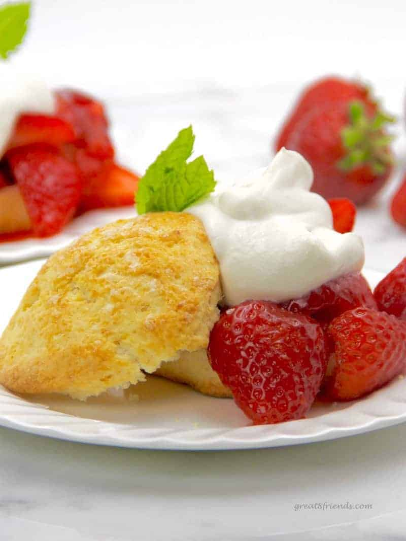 Strawberry Shortcake biscuits served with ruby red strawberries and whipped cream.
