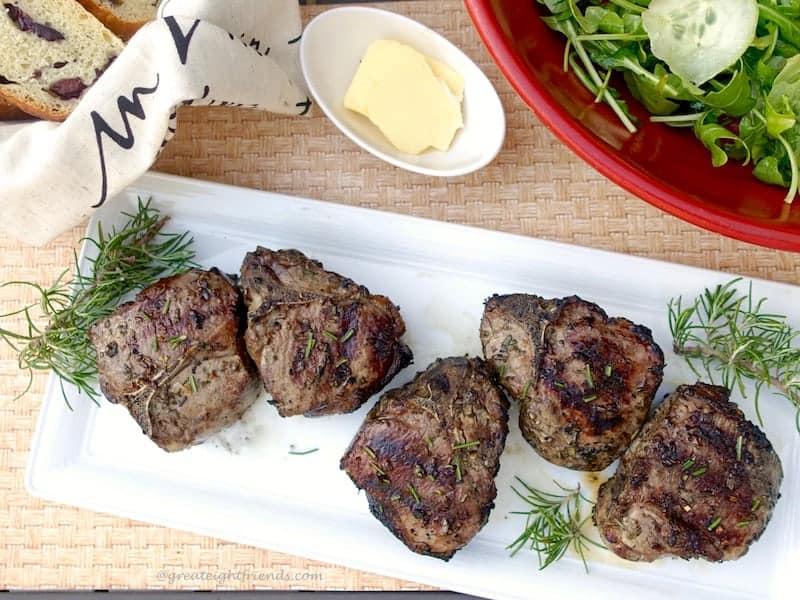 Grilled Lamb Chops on a rectangular platter.