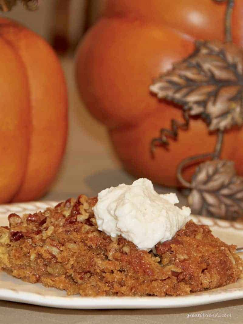 A piece of Pumpkin Pie Crunch Dessert with a dollop of whipped cream.