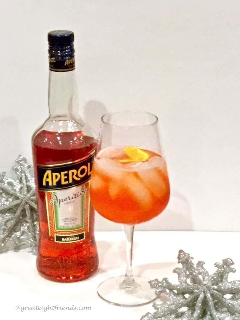 clink then drink aperol spritz