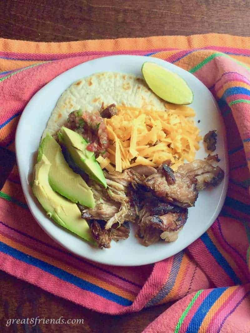 This Carnitas recipe is the tastiest and the easiest! Tasty because of the flavors of the oranges and herbs and easy because it cooks all day!