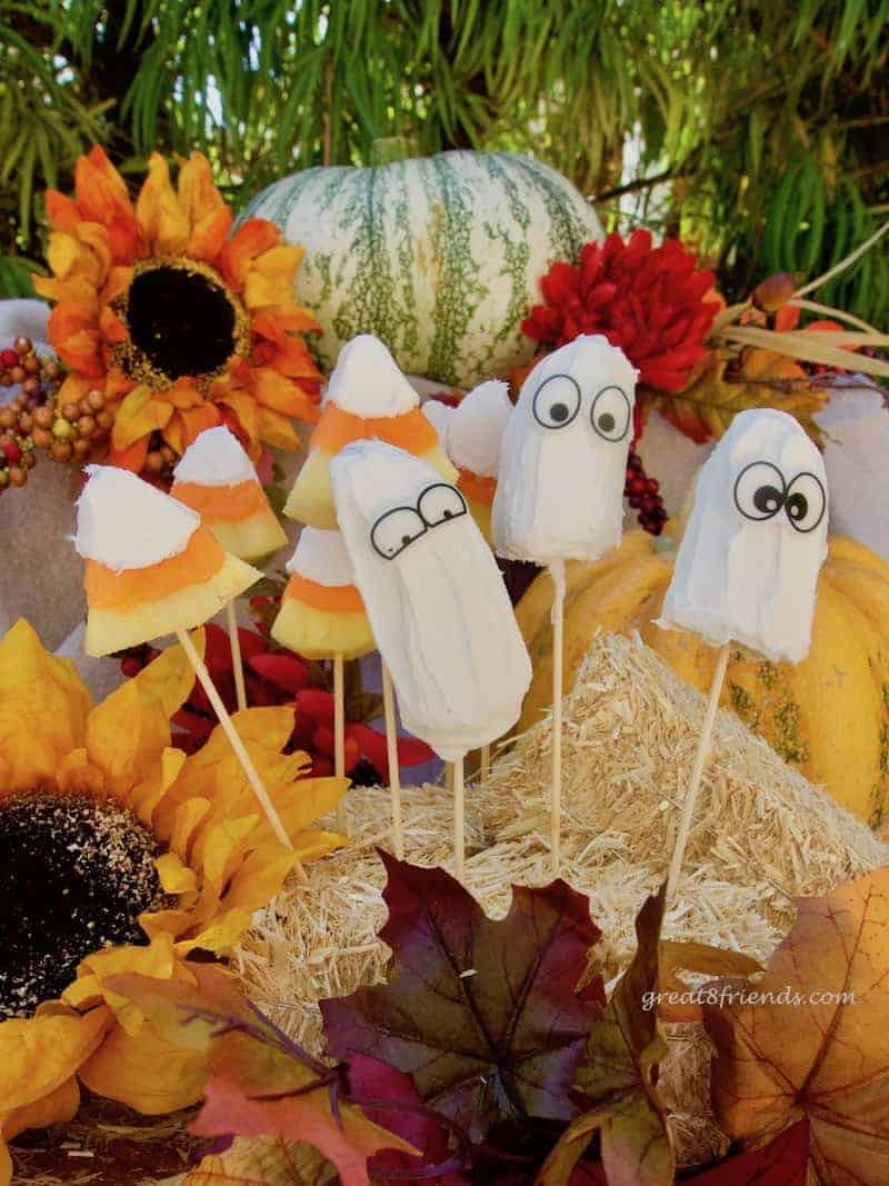 Fruit dressed in costume and ready for your All Hallow's Eve celebrations. These Halloween Candy Covered Fruit Treats are the perfect dessert!