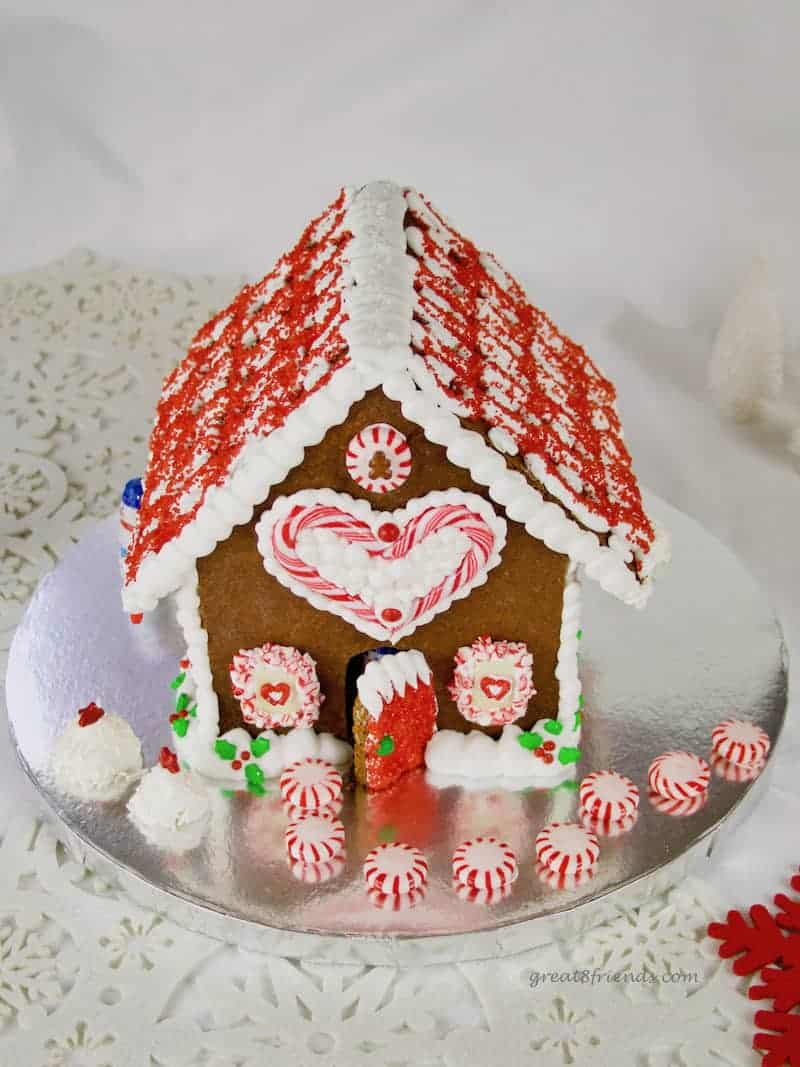 This festive Gingerbread House is a fun craft for your friends and family. Make this DIY edible Christmas decoration and delight the kids in your life.