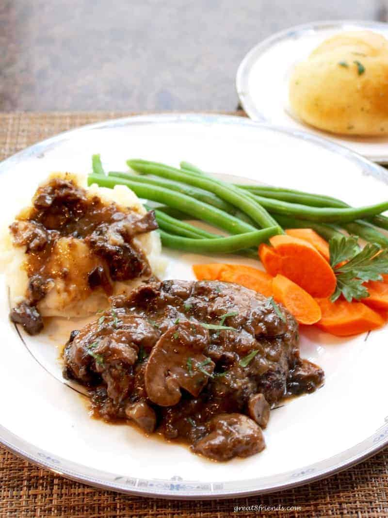 This Salisbury Steak with Mushroom Onion Gravy is the perfect melding of flavors and a comfort food that is a hit every time!