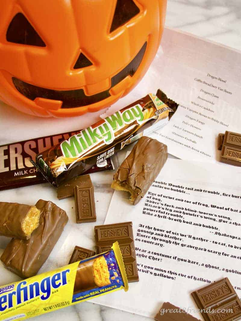 Halloween Haunt invitations, a plastic pumpkin, candy bars and the invitations.